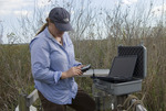 Laura downloading data on the autosampler platform at TS/Ph-2, Taylor Slough