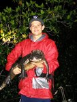 Adam Rosenblatt (PhD student) holding one of his study subjects, an American alligator, in the Shark River estuary