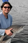 Bryan Delius (MS student) with a bull shark in Shark River