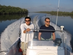 Left to right: Bryan Delius (MS student) and Mike Heithaus going to their study sites, which occur from the mouth of the Shark River to 30 km upstream