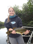 Jessica Lee holding a largemouth bass (Micropterus salmoides) by Virginia Fernandez