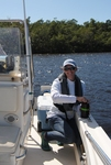 Sasha Wagner collects surface water samples to assess dissolved organic matter sources and reactivity along the Harney River by Evan Variano