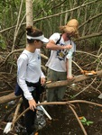 Sean Charles (FIU Ph.D. student) and Venus Garcia (FIU QBIC Undergraduate) collecting a soil core.