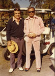 Charles Perry and Man Near Golf Carts by Florida International University