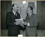 Charles Perry and Man Holding Document
