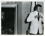 Charles Perry Standing Next to His Portrait