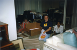 Tom Riley and Althea Silvera Packing the Charles Perry Papers by Florida International University