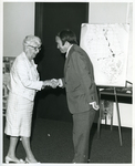 Charles Perry Shaking Hands with Marjory Stoneman Douglas, on April 4, 1973 for Friends of the Everglades by Florida International University