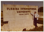 Charles Perry Standing in Front of FIU Sign