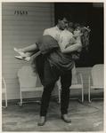 Tony Villar as Hal carrying Suzanne Kralik as Madge in Picnic